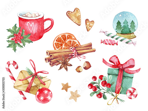Fotografía  Set of Christmas decorations of gift with candy, red cup with branch, cinnamon, gingerbread and various elements of the new year and Christmas