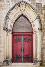 Red Ornate Church Door With Ir...
