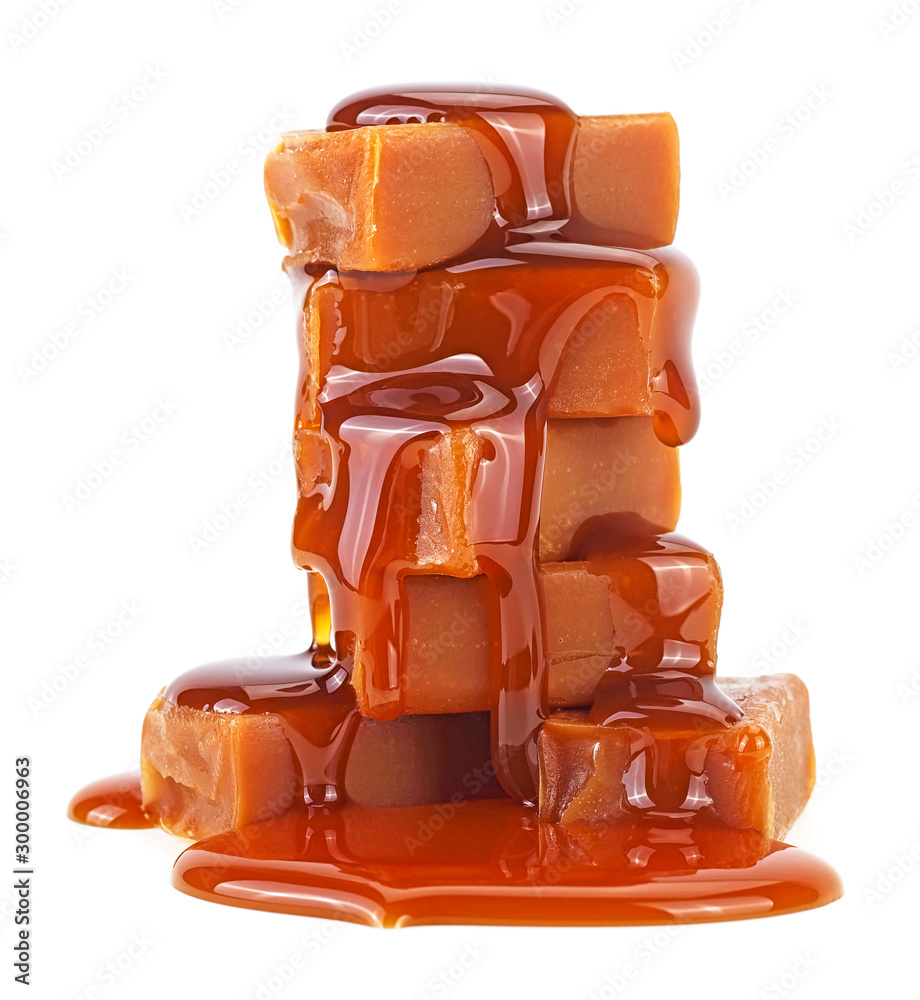 Fototapety, obrazy: Sweet caramel candies with caramel topping isolated on a white background
