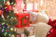 Leinwandbild Motiv Santa Claus putting gift box on mantelpiece, closeup
