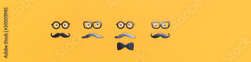 Four faces with mustaches and glasses for Movember on yellow orange Canvas Print