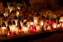 Candles Burning At A Cemetery During All Saints Day