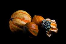 Ornamental Gourds On Black Background