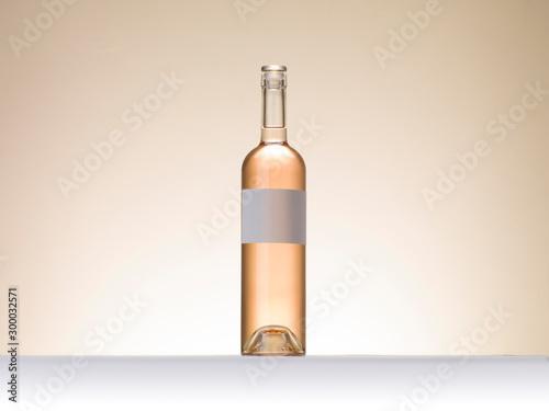 Bouteille vin rosé fond uni étiquette blanche personnalisante Canvas Print