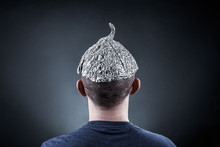 Young Man Wearing A Tin Foil Hat