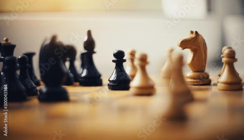Valokuvatapetti Wooden chess pieces on the chessboard.