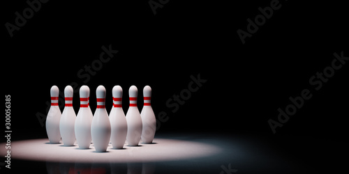 Canvas Print Bowling Skittles Spotlighted on Black Background