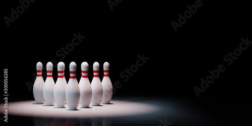Valokuvatapetti Bowling Skittles Spotlighted on Black Background