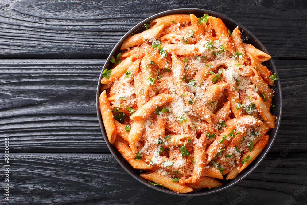 Fototapety, obrazy: Penne alla Vodkais a classic Italian pasta dish made with penne in a creamy tomato and vodka sauce close-up in a plate. Horizontal top view