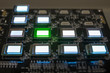 The process of checking several oled displays on the test station. Displays glow brightly of green and white color close up.
