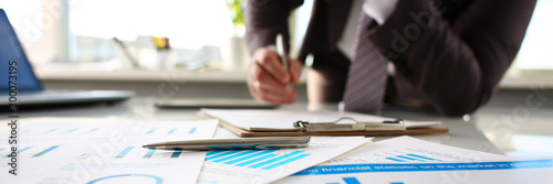 Obraz Silver pen lie at important paper on table in office - fototapety do salonu