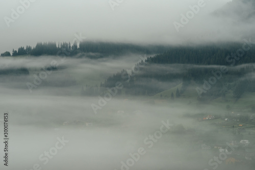 Photo Stands Pale violet Landscape. Morning in the mountains fog rises from the valley.