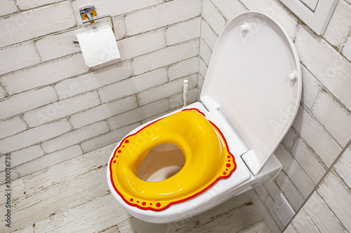 Yellow lid for toilet seat for children Wallpaper Mural