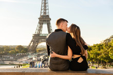 Love In Paris. Beautiful Couple Kissing Near The Eiffel Tower. Romantic Date, Honeymoon In Paris