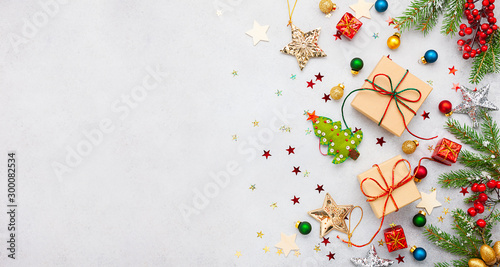 Fotobehang Londen Christmas background with gift boxes, festive decor, fir tree branches and paper cards notes. Flat lay.