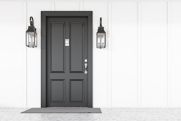Black front door of white house with mat