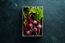 Fresh Beetroot With Leaves On A Black Stone Background. Healthy Food. Top View. Free Space For Your Text.