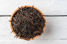 Wild Rice In Bowl On Rustic Wooden Table. Top View