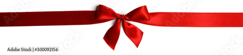 Red gift bow on white Fotobehang