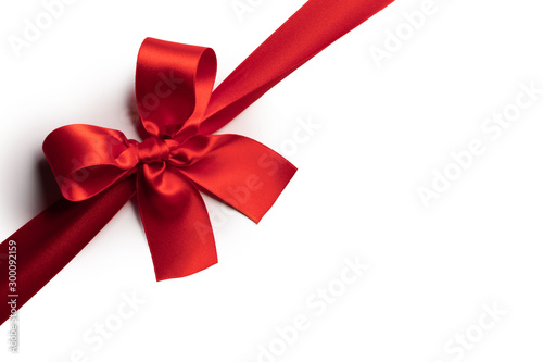 Leinwand Poster Red gift bow on white