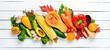 Fresh autumn vegetables on white wooden background. Healthy food.