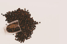 Coffee Beans In Cup And All Around. Background. Texture