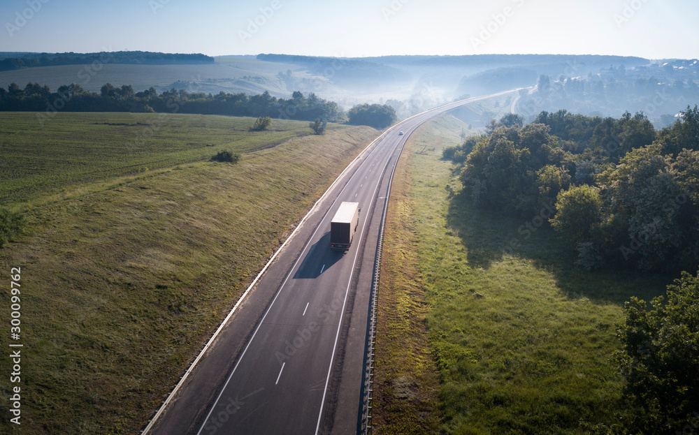 Fototapety, obrazy: Aerial Top View of White Truck with Cargo Semi Trailer Moving on Road in Direction