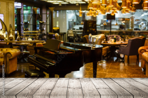 Image of wooden table in front of abstract blurred restaurant lights background. - 300099722