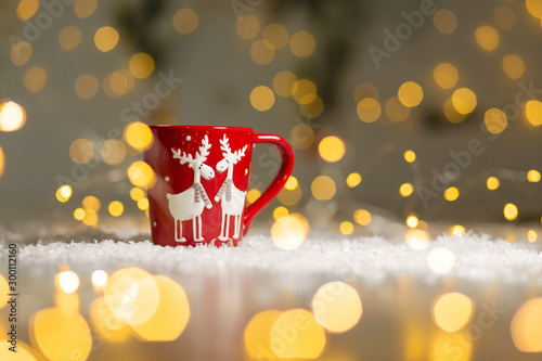 Recess Fitting Tea Christmas-themed mug with deer. Cozy warm family atmosphere, festive decor