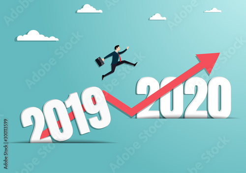 Fotografía  Businessman jumping to the new year of 2020