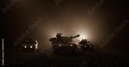 Fotografía  Military patrol car on sunset background
