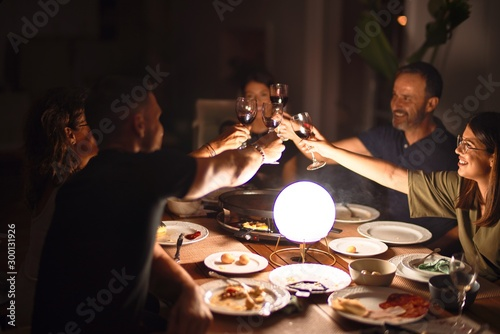 Obraz Beautiful family toasting with cup of wine on dinner smiling at terrace - fototapety do salonu