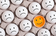 Be Different Concept.smiling Face Among Group Of Sad Faces