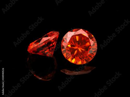 Cuadros en Lienzo Light Red Gemstone on a Black Background