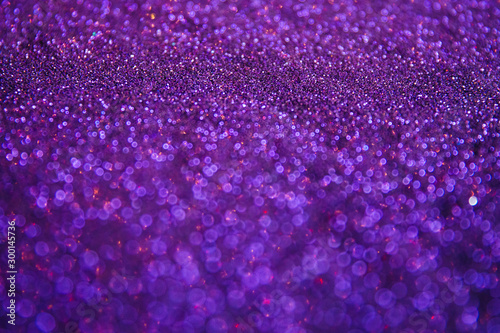 A stunning Christmas background, a Christmas background with magic sparkles and glowing powder of different colors, decorations for a higher event for the New Year and Christmas, a cozy home atmospher - 300145736