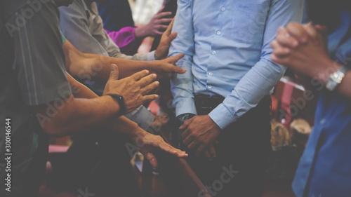 People praying together at Church. Fototapet