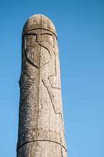 Wooden Idol Slavic God Perun On A Background Of Blue Sky