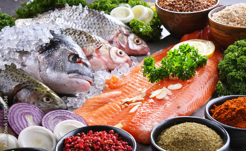 Different sorts of fish on kitchen table Tablou Canvas