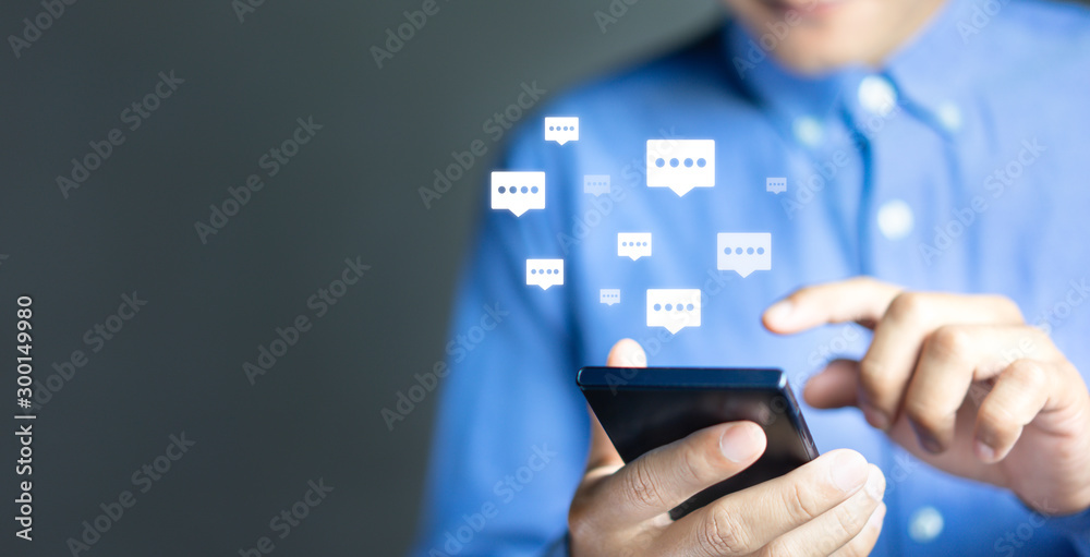 Fototapeta Live chat chatting and social network concepts, Close-up hands using mobile smartphone with chat box icons