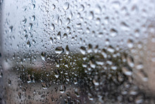 Water Drop Background On Window Glass In Rainy Day