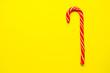 Leinwanddruck Bild - Christmas candy cane on yellow background