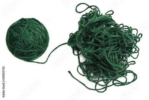 Fotografie, Obraz Ball of green fine wool ball thread and tangled thread on white background