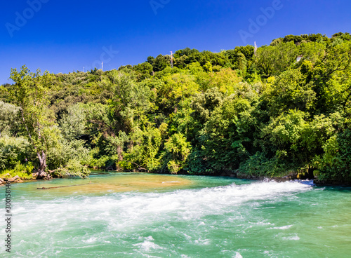 Narni, Umbria, Terni, Italy - Gole del Nera, a small lake formed by the Nera river. The open lock of the dam sends a strong jet of water.