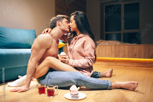 Young sexy couple after intimacy in kitchen in night Canvas Print
