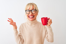 Middle Age Woman Wearing Glasses Drinking Red Cup Of Coffee Over Isolated White Background Very Happy And Excited, Winner Expression Celebrating Victory Screaming With Big Smile And Raised Hands