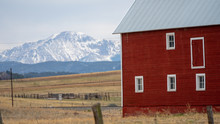 Red Barn Against Rocky Mountains
