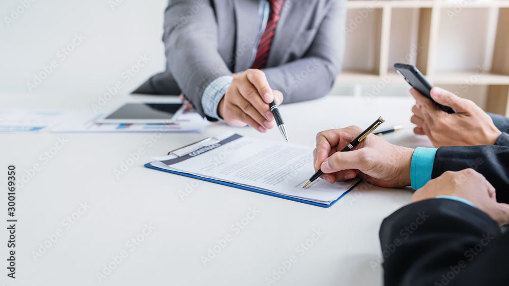 Fototapeta Business people sign financial business contract.