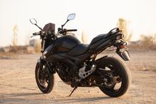 One Black Motorcycle In The De...