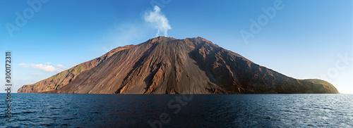Fototapeta The stromboli vulcano erupting on the Sciara del Fuoco north west side, day sh