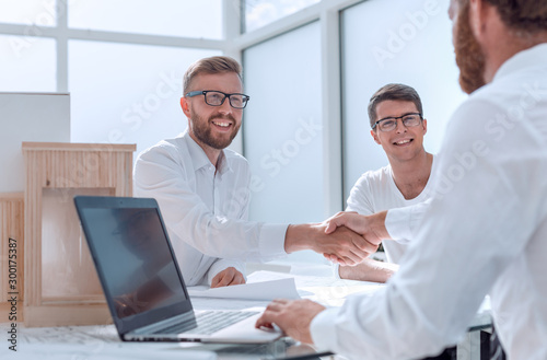 business people shaking hands in the architectural office